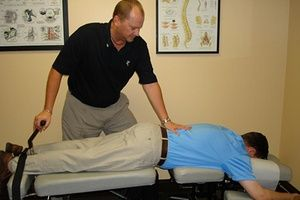 Chiropractor providing service